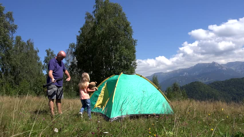 Tent On A Meadow The Hill Child Playing In Mountains Happy Family Trip Little Girl With Her Daddy Excursion Summer Vacation At Camping
