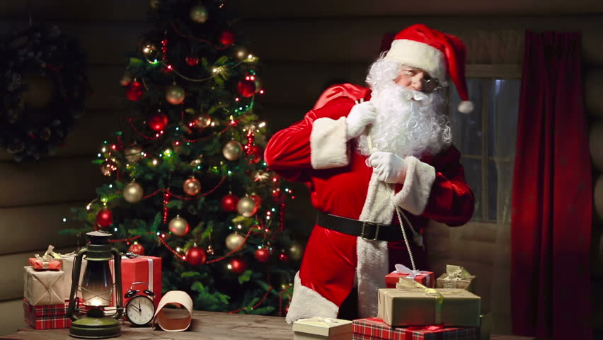 santa claus packing gift boxes in sack and waving hand stock footage video 7581382 shutterstock - Santa Claus With Presents