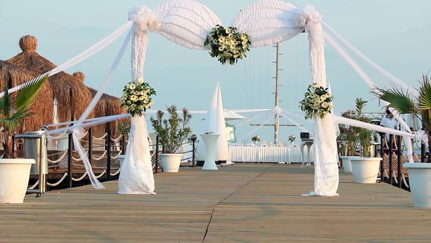 Beautiful wedding arch in wedding ceremony wedding decoration wedding ceremony arch decoration wedding arch decorated with flowers on pier hd stock junglespirit Gallery
