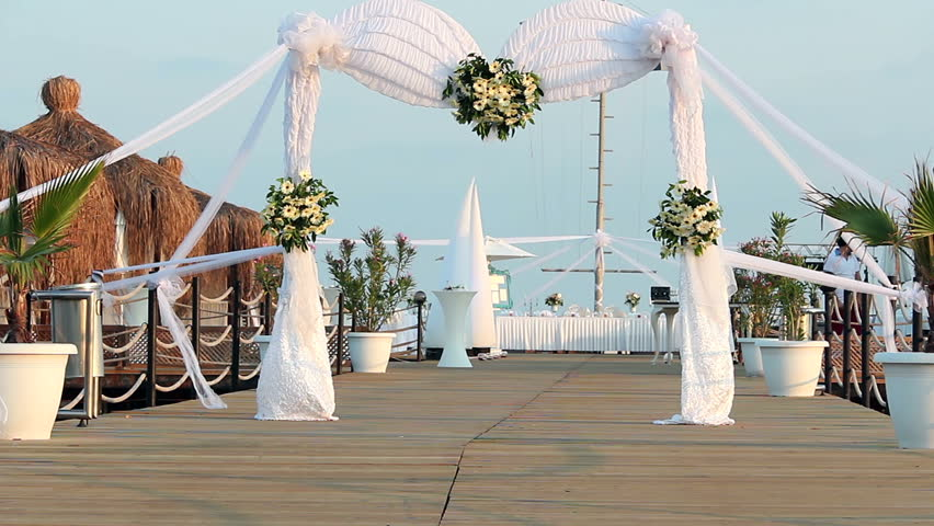 Wedding Ceremony Arch Decoration Decorated With Flowers On Pier
