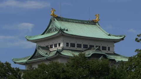 The main tower of Nagoya Castle in Nagoya City, Aichi Prefecture, Japan, with clouds moving over it.