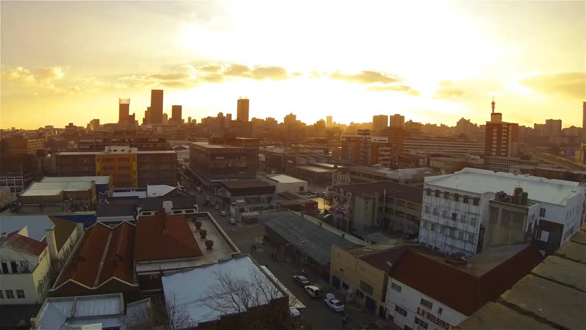 City skyline during sunset with clouds timelaps