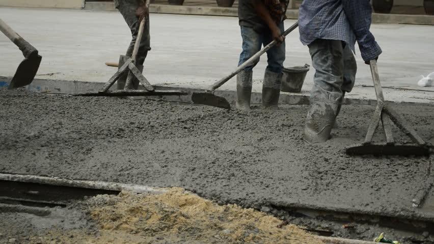 Fresh Cement Concrete Close Up Of Men Wearing Rubber