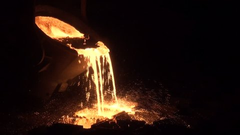 Iron and Steel Works. Pouring of molten iron.