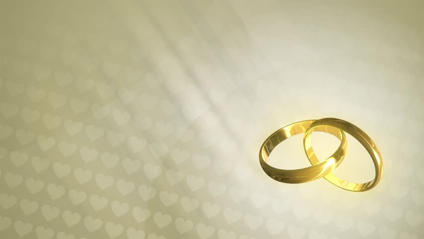 loopable animated background of three dimensional wedding rings revolving over a background of hearts - Wedding Ring Ceremony
