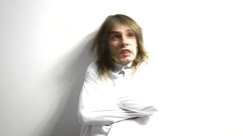 Psycho long haired man in straitjacket have psychosis attack. Isolated white. Madness.