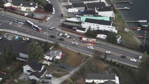 Tragic roadway accident on city street view from news aircraft
