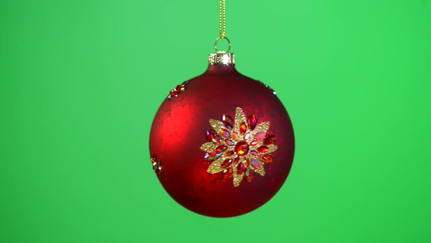 christmas and new year holiday decoration bauble rotation over green screen background blinking christmas ball on christmas tree