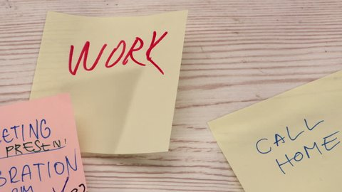 Office desk covered with different post it papers - closeup, stop motion animation, 4K