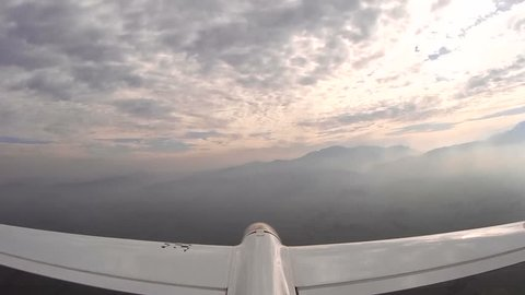 Sail plane, glider high in the clouds, Camera mounted on the elevator, with sound of the wind, 1080p, full HD
