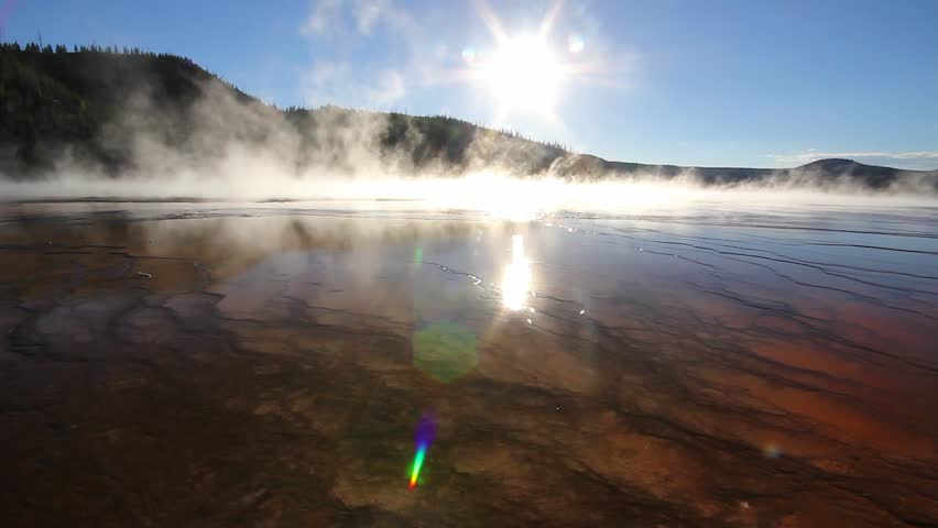 Steam rises off Grand Prismatic Spring at Midway Geyser Basin in Yellowstone National Park, Wyoming. | Shutterstock HD Video #7767682