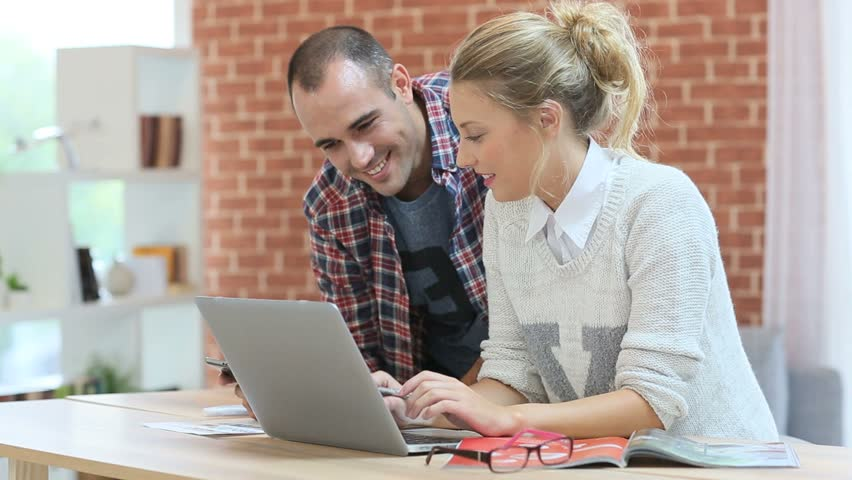 Young people at home websurfing on laptop   Shutterstock HD Video #7804591