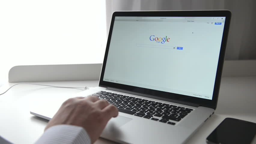 SIMFEROPOL, RUSSIA - NOVEMBER 01, 2014: Google webpage on Macbook Pro display. Google is an American multinational corporation specializing in Internet-related services and products