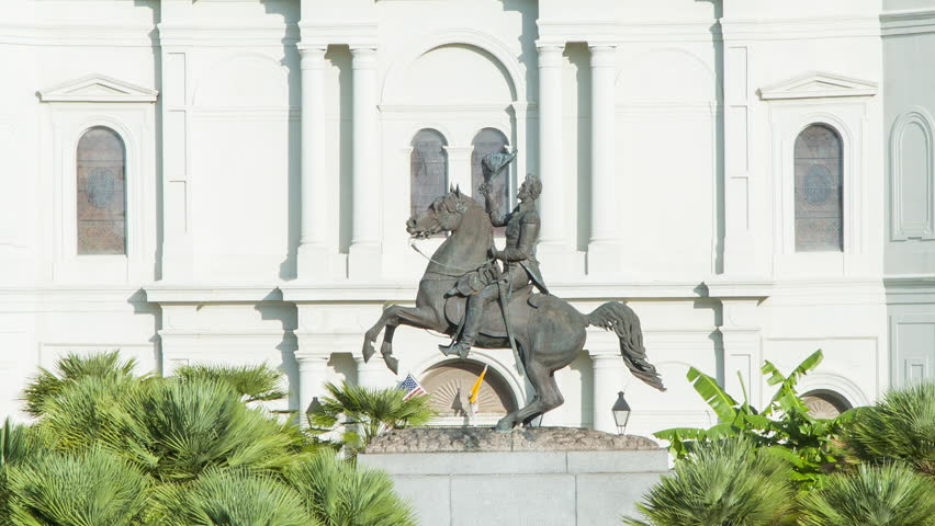 Andrew Jackson Statue on a Horse in Jackson Square of New Orleans LA in front of the St Louis Cathedral in the French Quarter against the Mississippi River with Sunlight in Louisiana