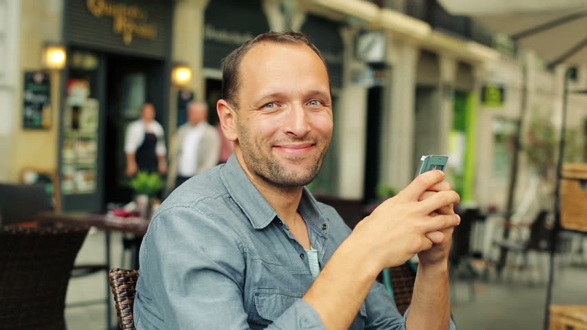 Happy young man with smartphone in the city  | Shutterstock HD Video #7845742