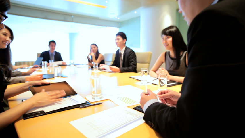 Boardroom conference meeting teamwork ethnic executive management planning business businessman businesswomen wireless laptop computer | Shutterstock HD Video #7852177