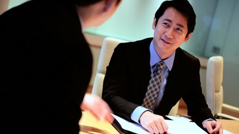 Asian Chinese ethnic young male business executives consultants city boardroom meeting teamwork management communication conference
