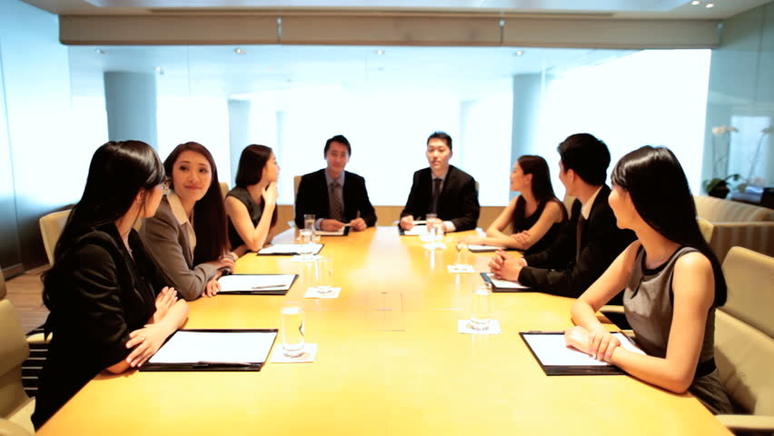 Young teamwork male female corporate executive management planning meeting boardroom wireless video uplink global communication | Shutterstock HD Video #7852837