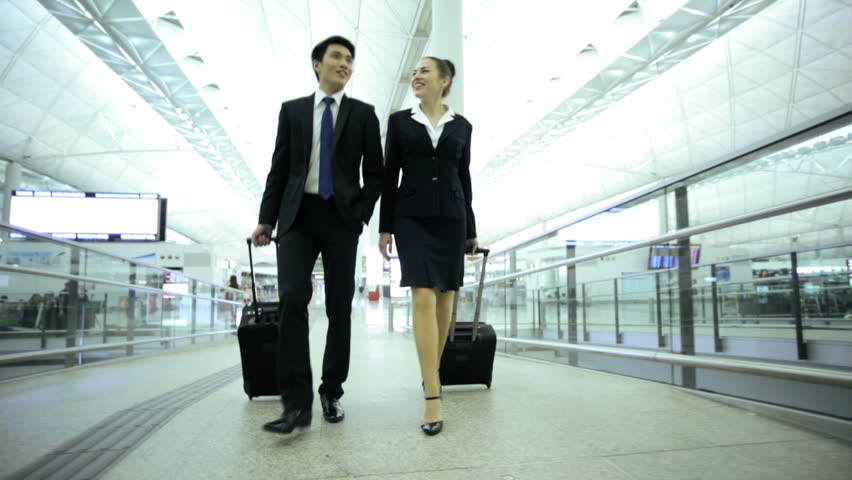 American Asian Chinese Caucasian male female colleagues airport passenger travel business meeting information departures executive traveller | Shutterstock HD Video #7854454