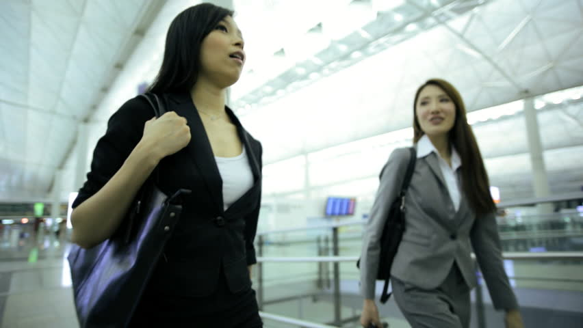Young Asian Chinese smart suit females business travellers airport terminal atrium conference meeting professional corporate management | Shutterstock HD Video #7854751