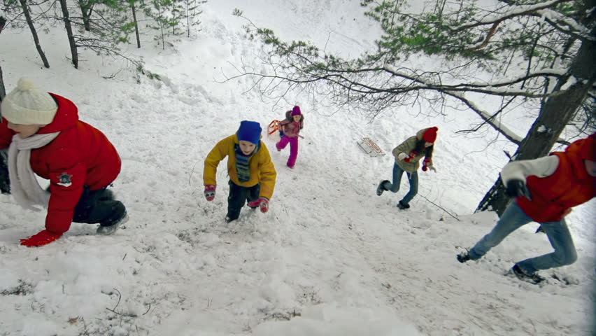 Right from above view of five jolly children climbing up the snowy hill | Shutterstock HD Video #7870096