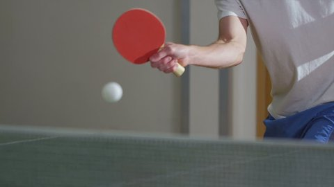 Slow motion clip of a man serving in table tennis, shot on RED EPIC