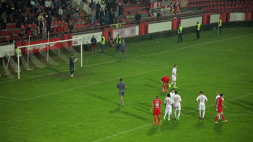 Srbija, Krusevac, 2014. FC Napredak - FC Radnicki. Football. Soccer. Penalty. Shot. Goal. Score. Celebration. Tracking shot to the center. Two football clubs playing championship derby match. 30 fps.