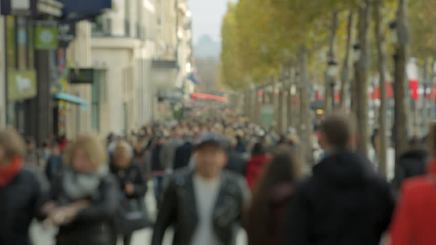 Crowded street Champs-Elysee in Paris. People and tourists are walking in the main street in Paris, France. This shot is ideal for representing anonymity in a big city, tourism or consumerism.  | Shutterstock HD Video #7910662