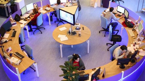 MOSCOW, RUSSIA - MAR 5, 2013: Top view of working people in big office of RIA Novosti russian news agency