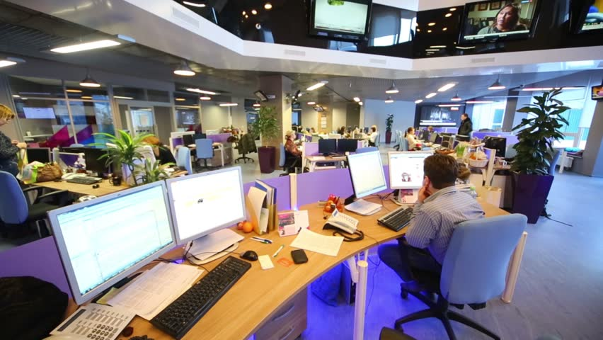 MOSCOW, RUSSIA - MAR 5, 2013: Staff work at computers in modern office of RIA Novosti russian news agency