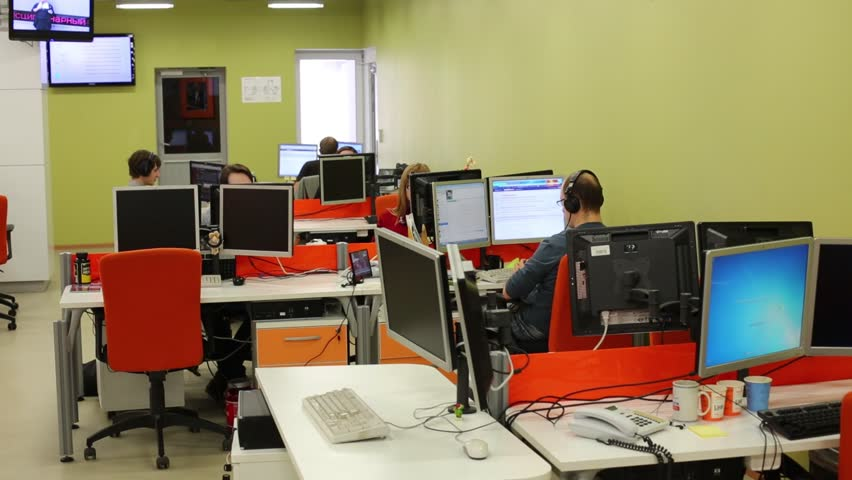 MOSCOW, RUSSIA - MAR 5, 2013: Employees work at computers in modern office of RIA Novosti russian news agency