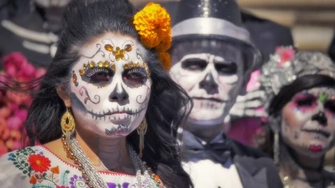 GUANAJUATO, MEXICO - M2 NOVEMBER 2014: Models dressed with traditional costumes and makeup of mexican skull called Catrina in the day of the dead