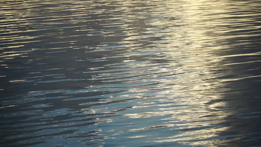 Calm Water Texture calm water with sun reflection at dawn. stock footage video