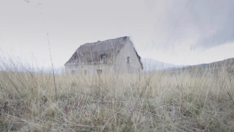 Old spooky scary horror abandoned house in a middle of nowhere. Slider/ dolly shot