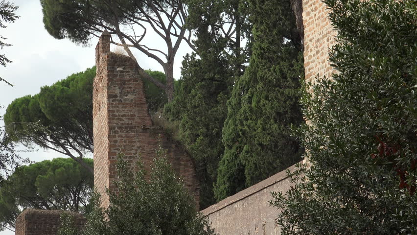 ROME - OCT. 2014:  Section of the Aurelian Walls that still encircle old rome; built under Emperor Aurelian in late 2nd Century AD, still remarkedly intact, here near Porta San Paolo.