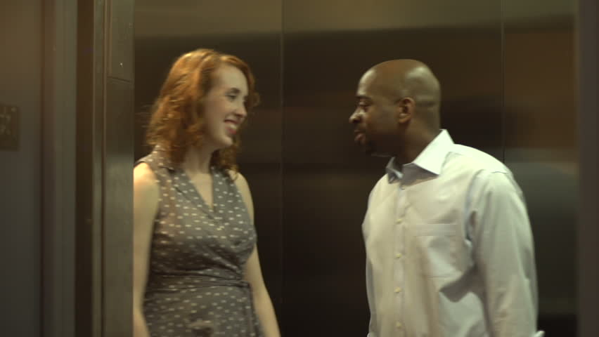 A Pan Right To Reveal A Happy, Playful Interracial Couple -9012
