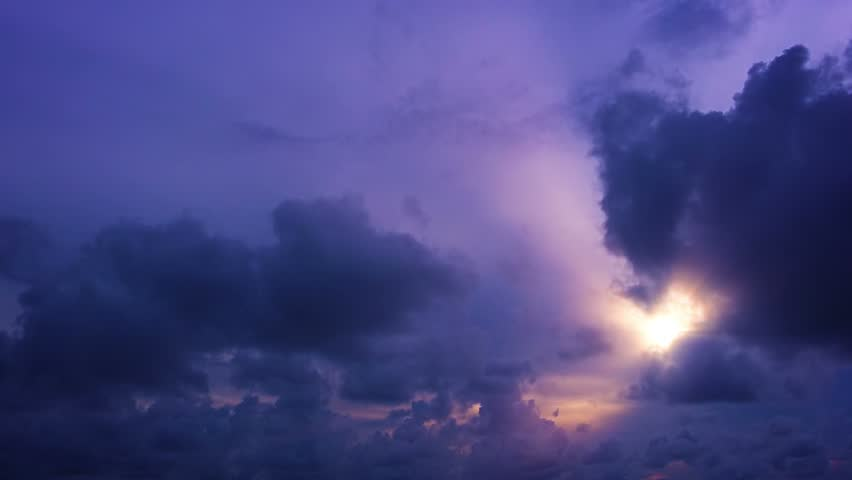 Video 1080p - Timelapse at sunset. The sun sets in the clouds #8074882