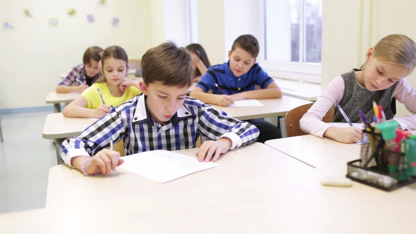 Elementary Classrooms Writing ~ Children drawing at school in slow motion stock footage