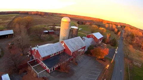 Working farm aerials, barn and buildings. Upstate New York. Float over differt views of farm, in late afternoon late fall light, very clear light. Aerial Farm views, HD 60FPS close up and personal.