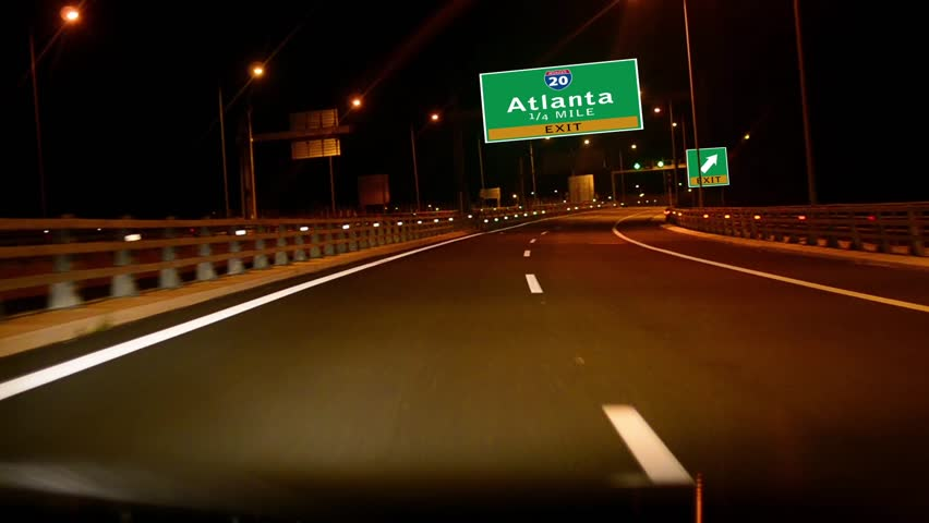 Driving on Highway/interstate at night,  Exit sign of the City Of Atlanta, Gorgia