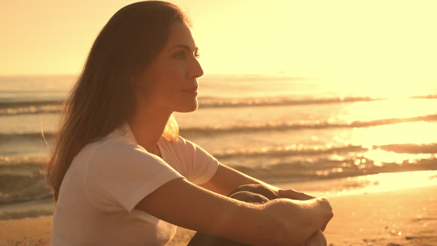 Woman Sitting On Beach Relaxing In Sunset. #8186452