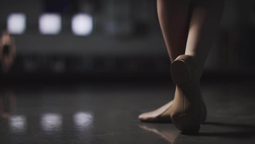 Ballet, Ballerina Dancer spins elegantly in a dance studio in slow motion
