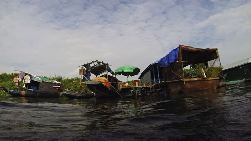 Panning view of a floating village on  Tonle Sap lake near Siem Reap Cambodia. Recorded at 60fps