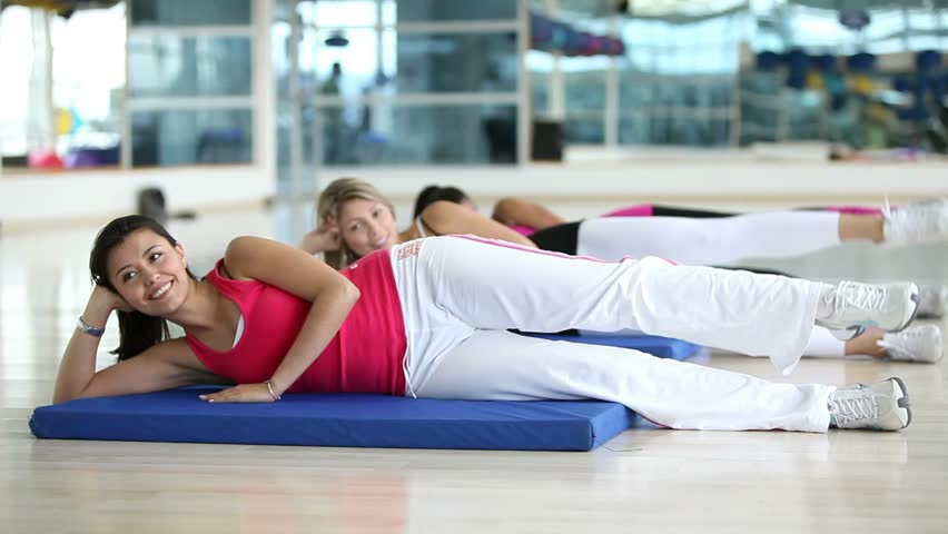 Group of women lying on the floor exercising at the gym