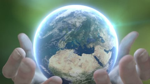 Holding earth 2. Zoom out. Nature background.