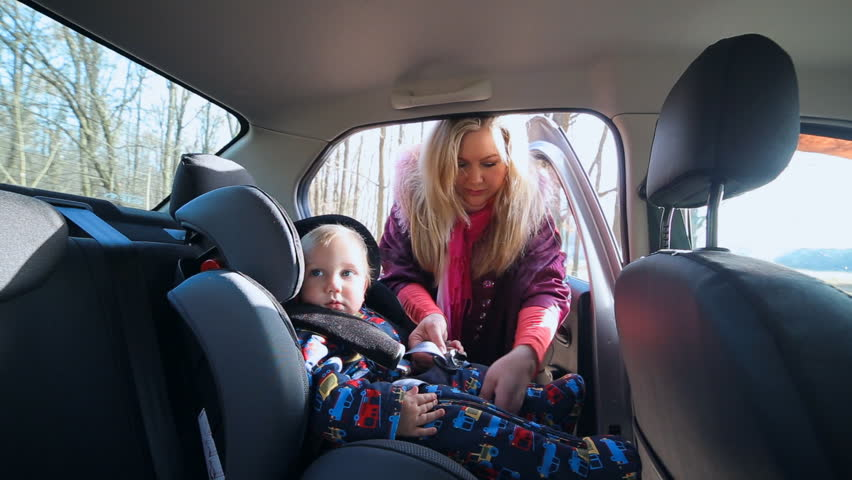 baby rides in a car seat toddler kid boy child boy with mam in