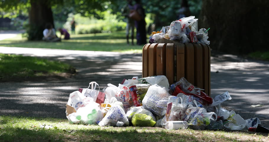 LONDON, ENGLAND, - AUGUST 15, 2013 Dumpster Full Garbage Nature Park Litter Picnic Trash Cans Dump Wrappers Waste ( Ultra High Definition, UltraHD, Ultra HD, UHD, 4K, 2160P, 4096x2160 )