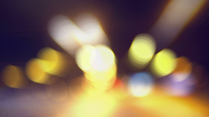 Drunk driving a car in the night. Dangerous usage of a motorized vehicle under the influence of liquor, with bokeh lights from the headlights. 1920x1080 full hd footage. | Shutterstock HD Video #8282464