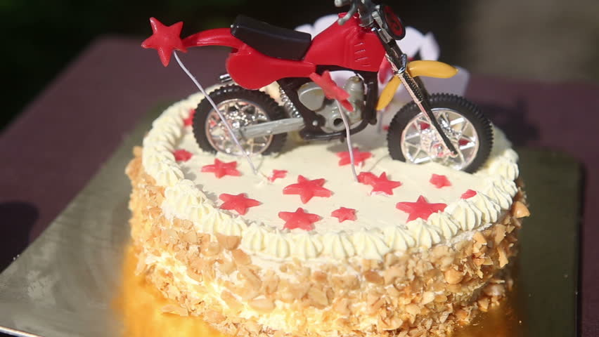Close Up Birthday Cake With Nuts And Vanilla Cream Decorated With
