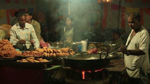 PUSHKAR,INDIA - November 2,2014 : Unidentified indian people cooking traditional Chapati and Kachori in pushkar mela,India